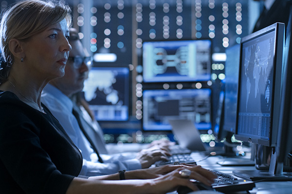 woman on cybersecurity team in front of computer