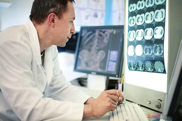 Doctor looking at scans on computer