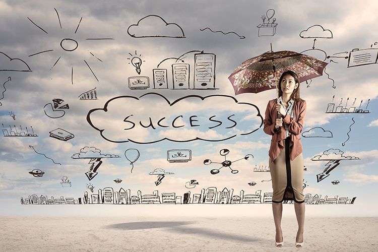 businesswoman holding umbrella with cloud computing drawing