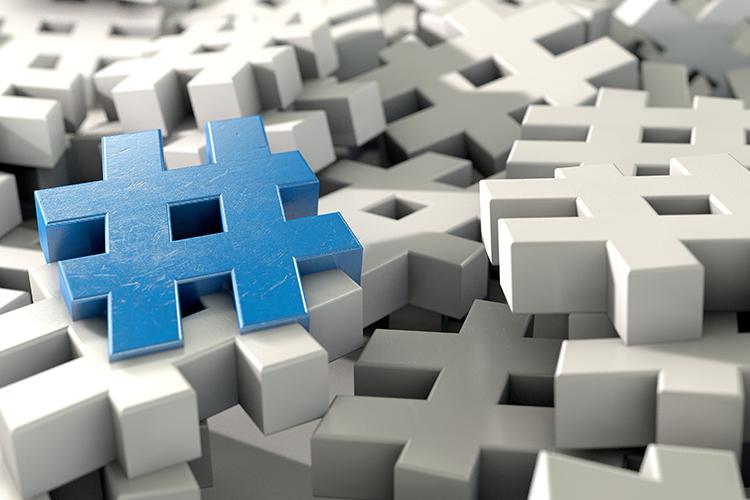 blue hashtags on pile of white hashtags