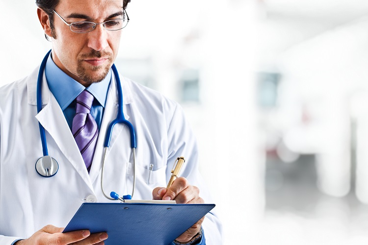 Doctor writing a prescription on tablet