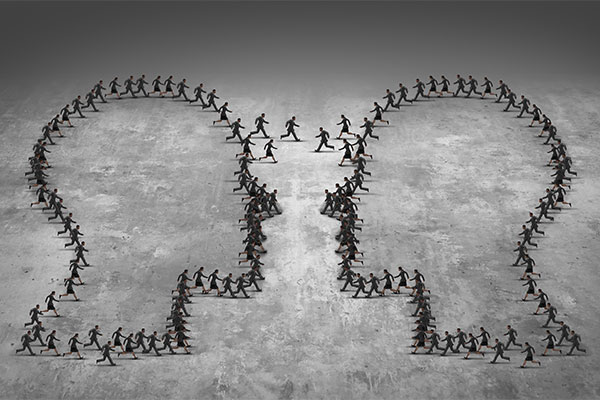 People walking back and forth between two teams shaped like heads