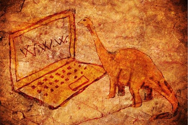 prehistoric petroglyph with computer and dinosaur