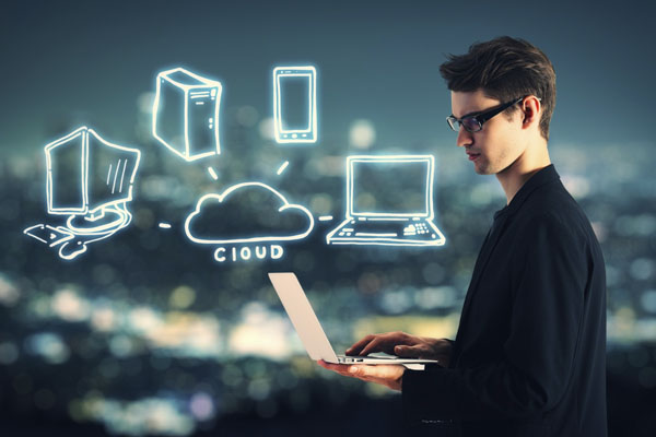 man with laptop and abstract image of connected devices in the cloud
