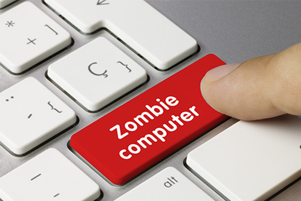 Finger pressing zombie computer button on keyboard