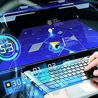 Man on laptop using automotive software