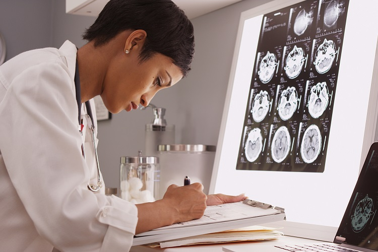 neurosurgeon evaluating scans