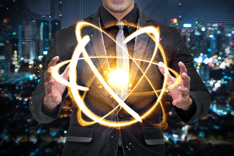 Quantum computer technology concept. Man suit holding science yellow shining cosmic atom nuclear.