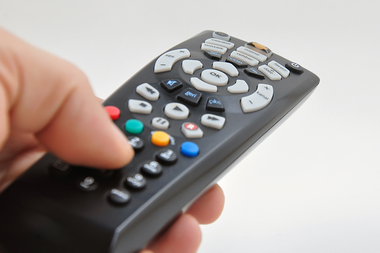 pressing button on tv remote control