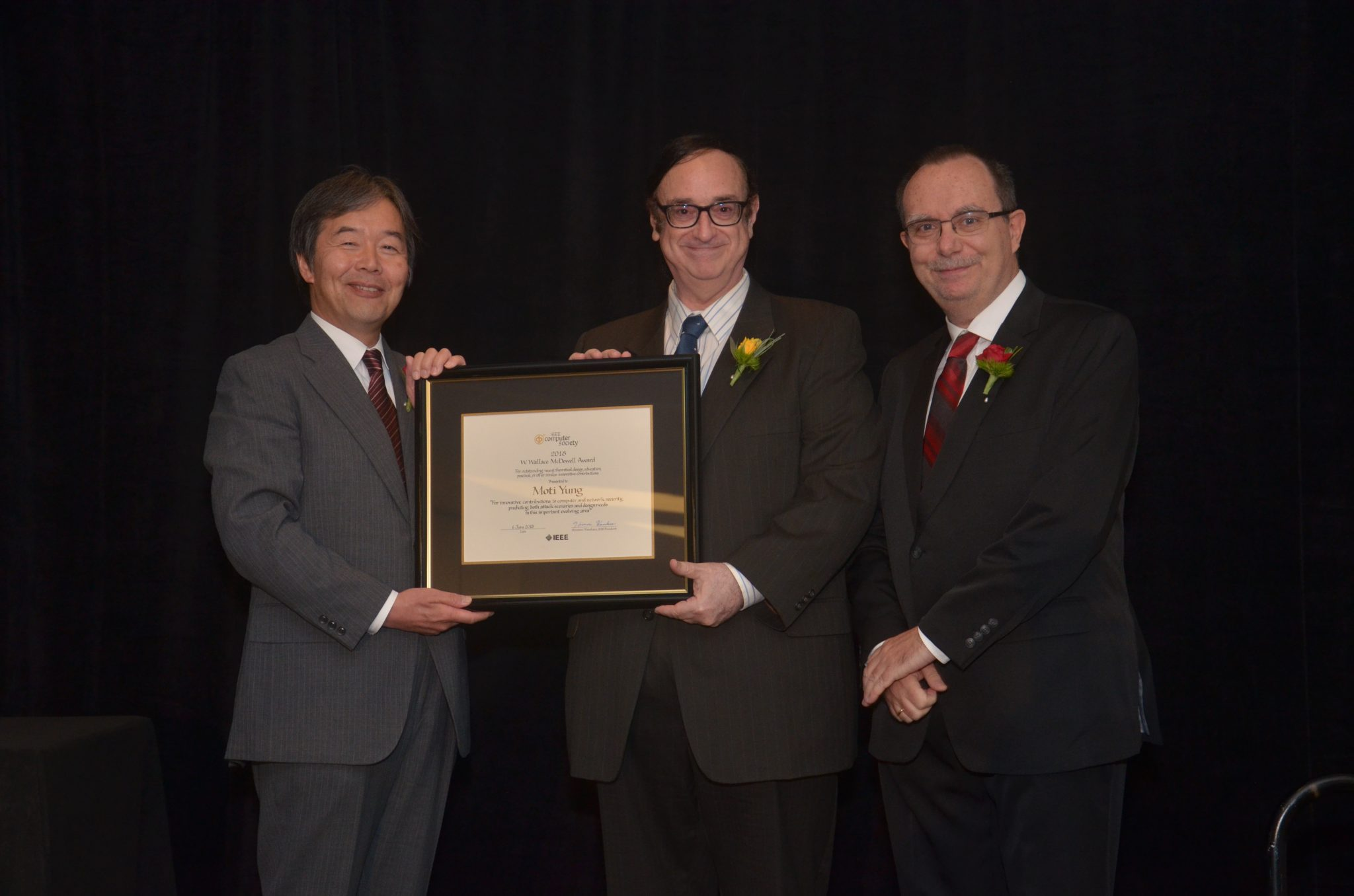 Dr. Moti Yung (center), fellow of IEEE and ACM, receives the IEEE Computer Society 2018 W. Wallace McDowell Award.