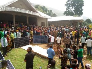 Village people helping to install solar panel